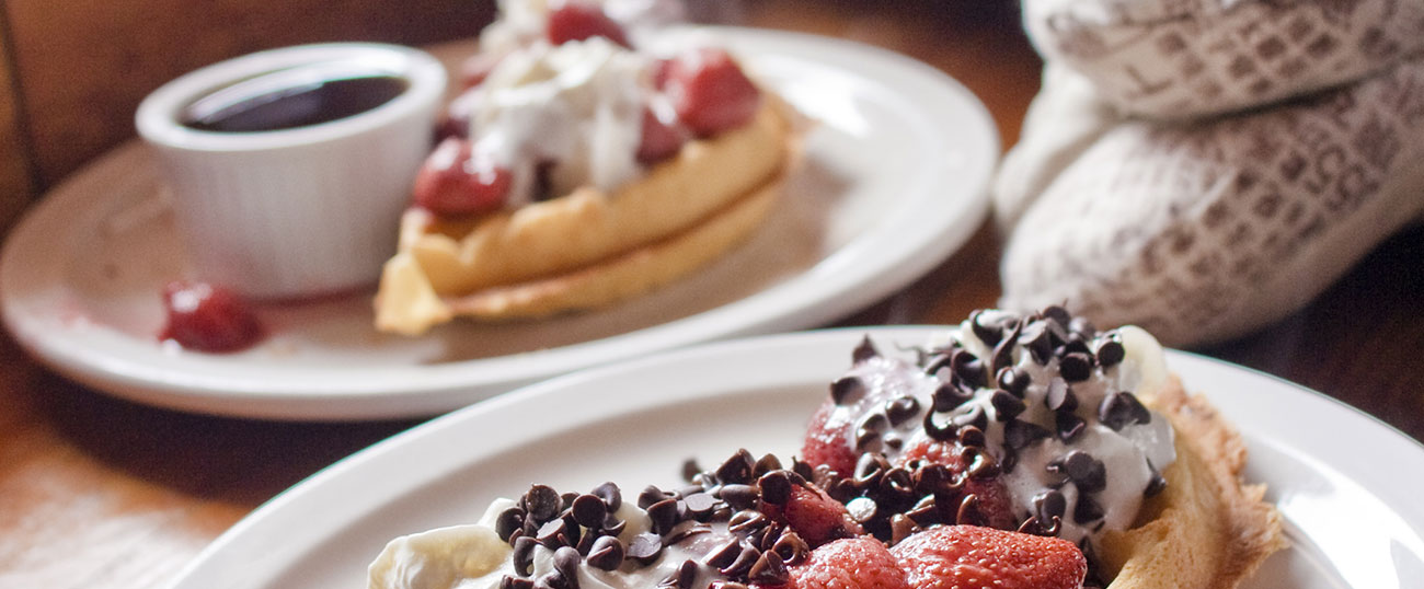 Crepes with strawberries and chocolate grater