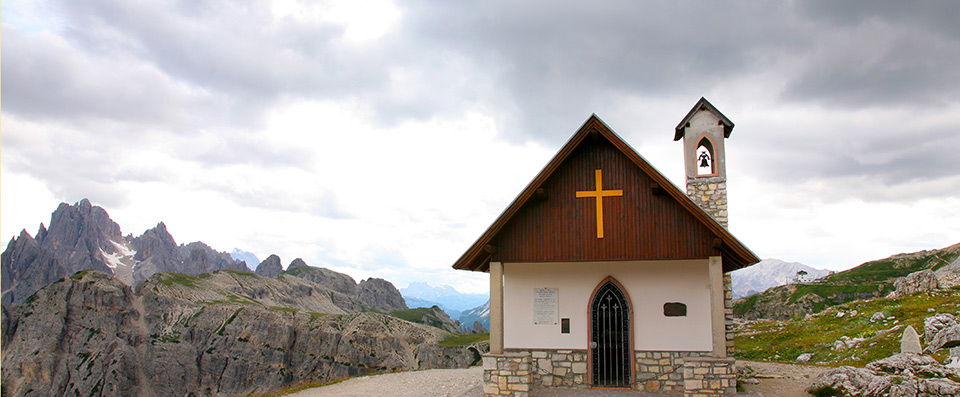 A isolated chapel in the middle of nowhere on the peak of a mountain in Plan de Corones